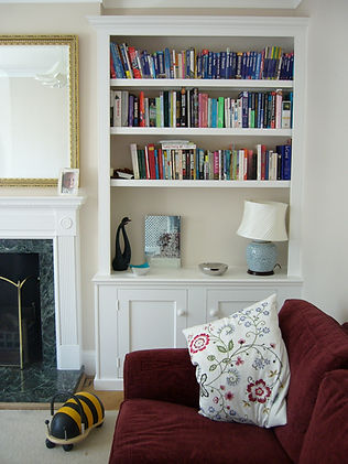 built-in Shaker style 2 door alcove cupboard and bookcase