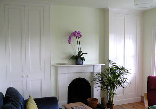 built-in pair of two door wardrobes in alcoves