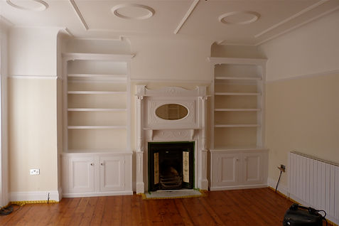 built-in pair of 2 door alcove cupboards and bookcases