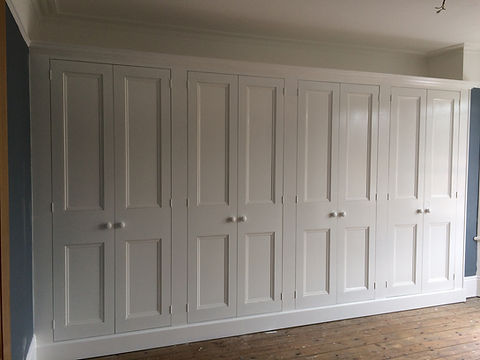 built-in wall to wall 8 door wardrobe
