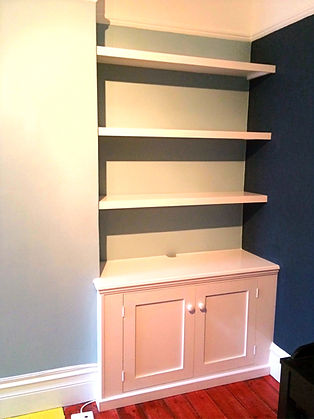 built-in chunky shelves above 2 door alcove cupboard