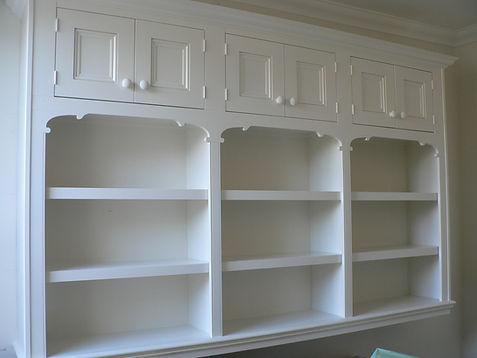 wall mounted bookcase with top cupboards and decorative features