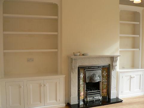 built-in Victorian style 3 door alcove cupboard and bookcase and 2 door alcove cupboard and bookcase
