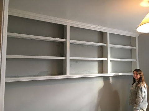 built-in wall to wall high bookcase in three section splits