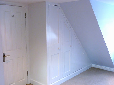 built-in under-eaves 3 door sloping wardrobe