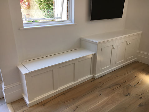 built-in three door alcove cupboard and panelled toy box with hinged lid