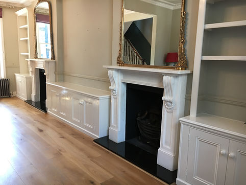 built-in pair of Victorian style alcove cupboards and bookcases with 4 door low cupboard between