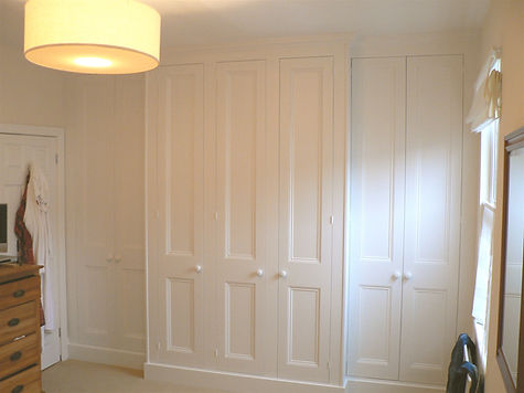 built-in wall to wall breakfront 7 door wardrobe