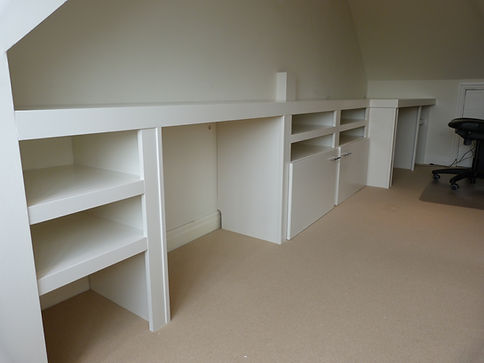 built-in wall to wall large desk with modern shelving and cupboard storage below
