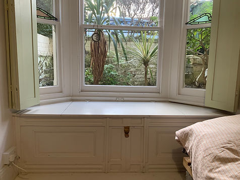 built-in window seat with lid, storage cupboard