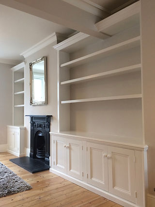 built-in 4 door alcove cupboard and bookcase and 2 door alcove cupboard and bookcase