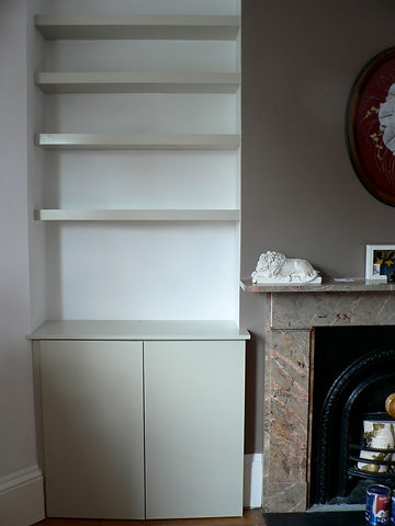 built-in chunky floating shelves and modern alcove cupboard with 2 flat doors