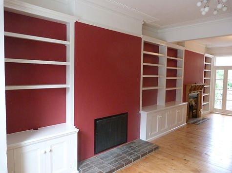 built-in 4 door alcove cupboard with split bookcase, 2 door alcove cupboard and bookcase and full length alcove bookcase in large open plan lounge