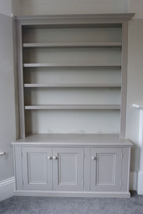 built-in 3 door alcove cupboard and bookcase