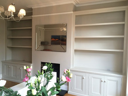 built-in pair of three door alcove cupboards and bookcases