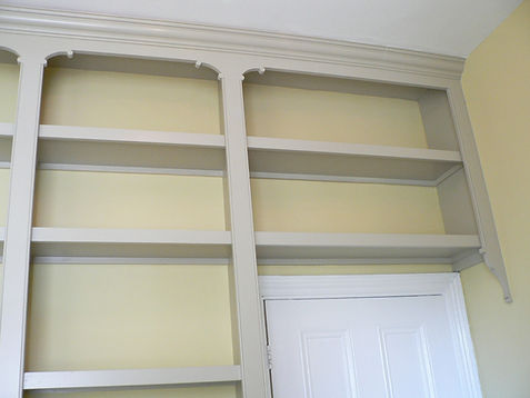 wall to wall bookcase surrounding doorway