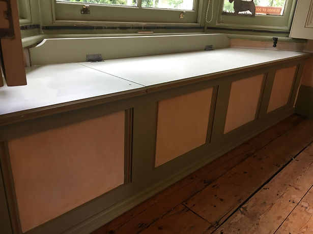 built-in panelled window seat for storage