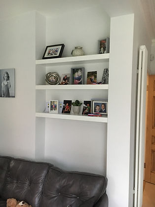 built-in chunky floating shelves in alcove