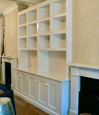 built-in chunky cubbyhole shelving unit with 5 door alcove cupboard at base