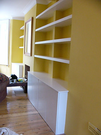 built-in chunky floating shelves above 4 door and 2 door alcove cupboards, modern flat doors