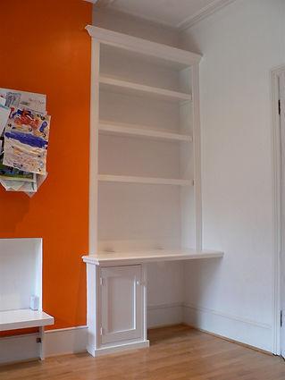 built-in desk, single door cupboard and bookcase in alcove