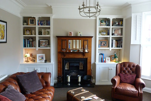 built-in Victorian style pair of 2 door alcove cupboards with split bookcases with decorative features