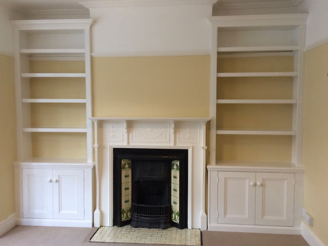 built-in pair of traditional Victorian alcove cupboards and bookcases