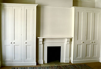 built-in pair of painted three door wardrobes