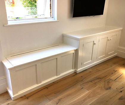 built-in painted 3 door Shaker style alcove cupboard and 3 panelled storage box, window seat