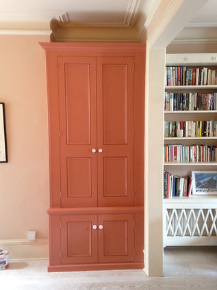 built-in four door cupboard two small doors at bottom, two tall doors above