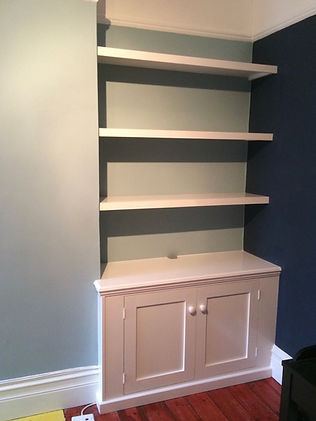 built-in Shaker style alcove cupboard with floating shelves above