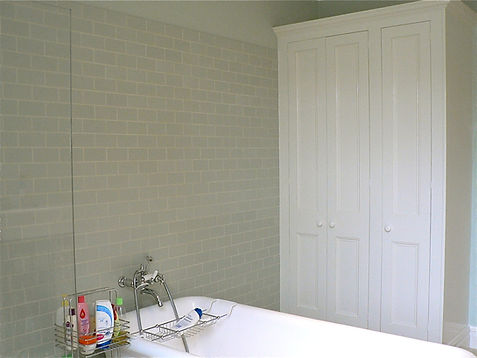 built-in 3 door wardrobe, towel, airing cupboard in bathroom