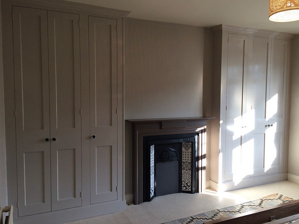 built-in pair of Shaker style 3 door wardrobes