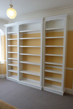 built-in breakfront library bookcase, three sections