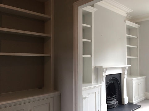 built-in, three 2 door alcove cupboards and bookcases