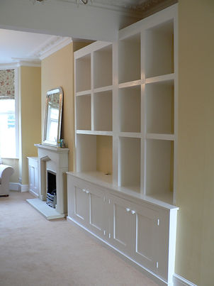 built-in chunky cubbyhole shelving unit with 4 door alcove cupboard at base