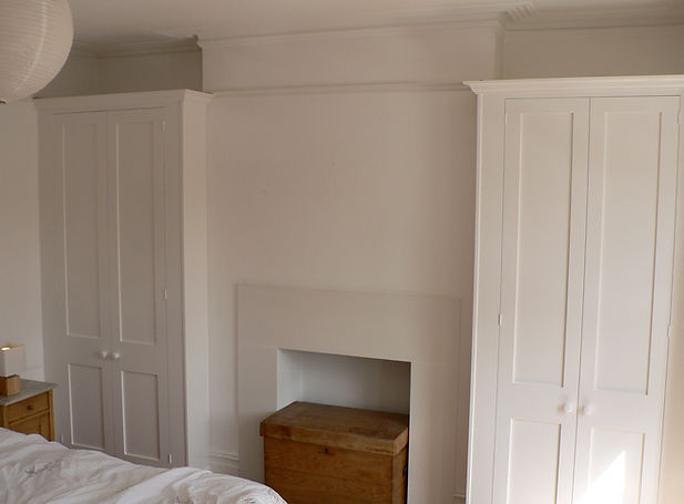 built-in pair of Shaker style wardrobes in bedroom alcoves