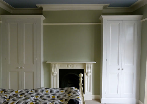built-in pair of 2 door wardrobes in alcoves