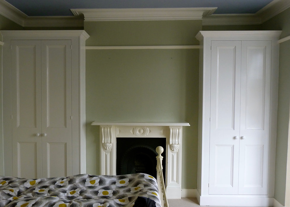 built-in pair of classic painted two door wardrobes