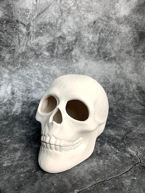 small realistic skull tealight
