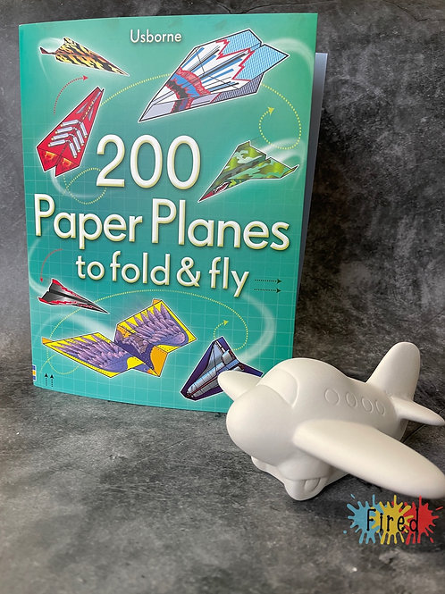 Plane pottery and a paper planes book