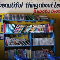 Bookshelf at Maanu Mwambi School.JPG