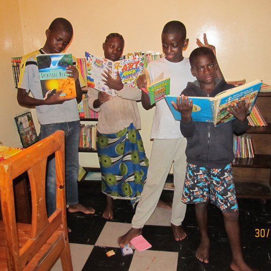 Youngsters reading books at Funsani Home