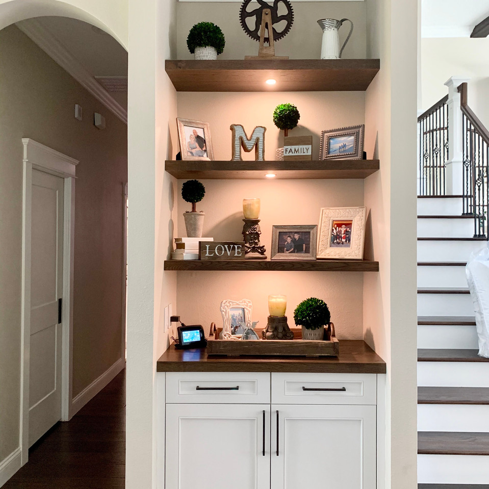 Anoth corner got a matching built in, this one with floating shelves and LED puck lighting