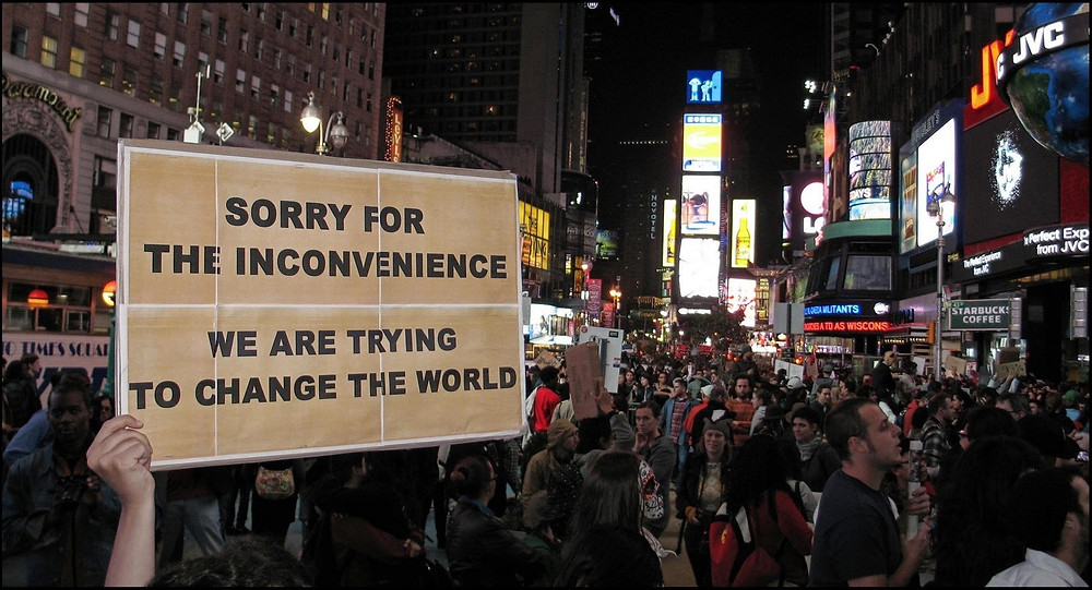 change-the-world-sign-from-ows.jpeg