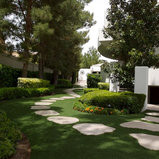How can a combination of pavers and synthetic grass upgrade your outdoor living space?