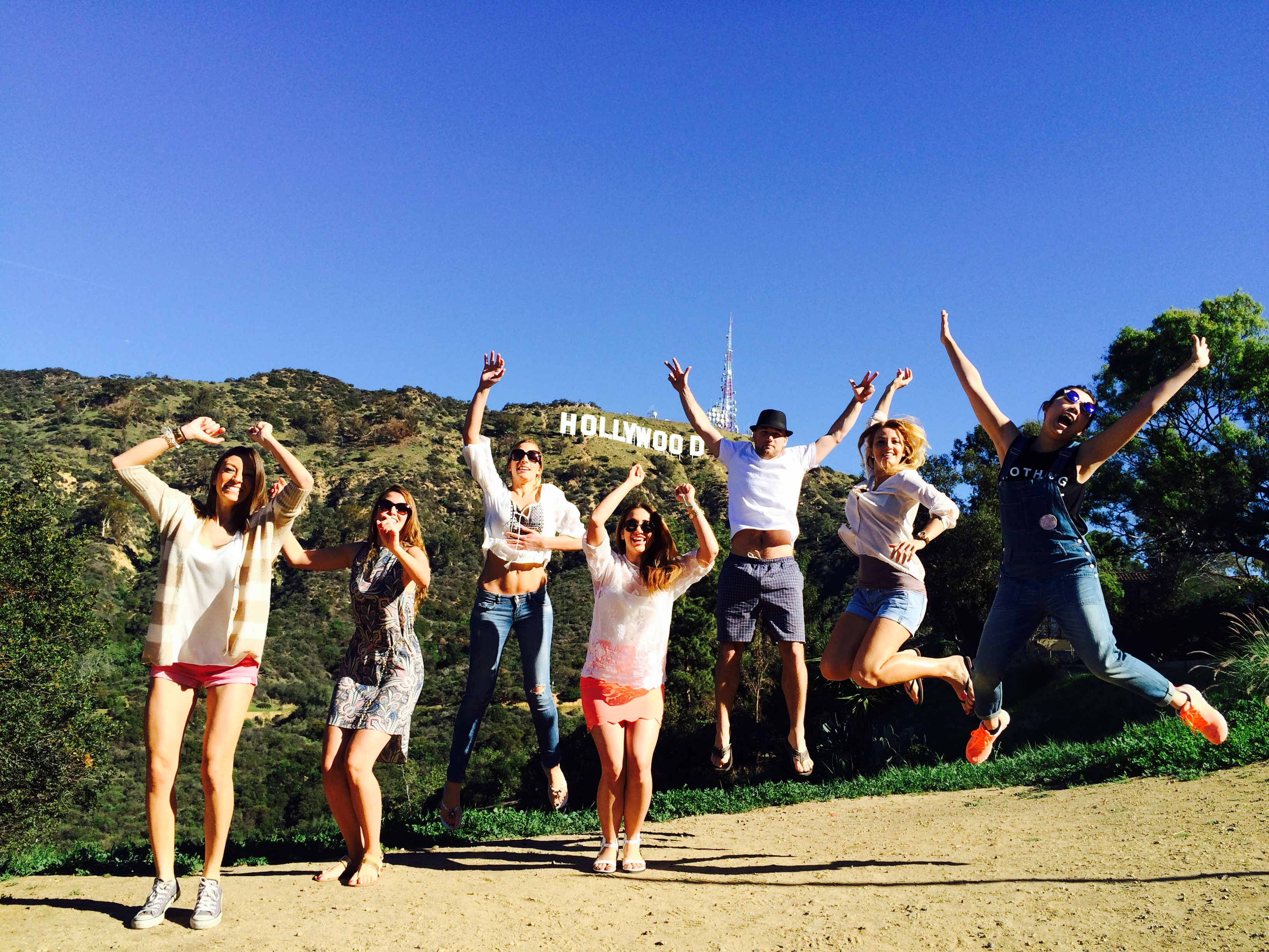 Friends jumping at Hollywood Sign