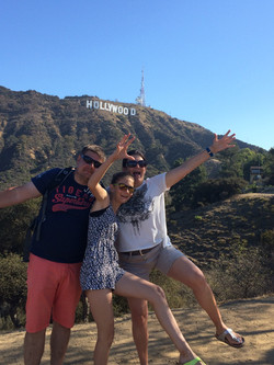 3 happy friends near Hollywood Sign