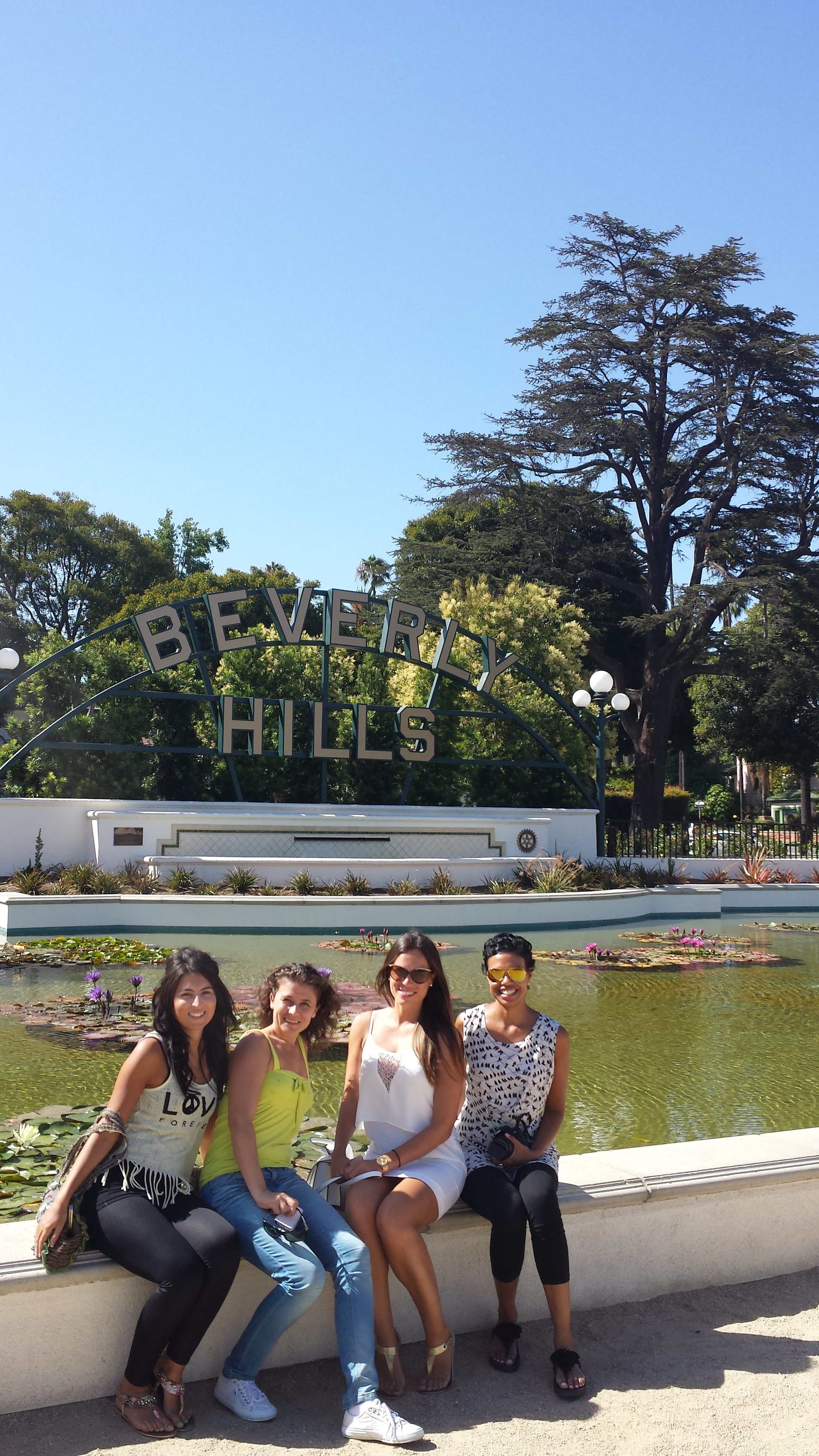 4 girlfriends at Beverly Hills Sign