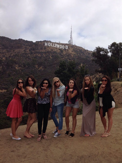 Blowing kisses at the Hollywood Sign